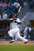 Yermin Mercedes (27) of the Charlotte Knights follows through on his swing against the Scranton/Wilkes-Barre RailRiders at BB&T BallPark on August 13, 2019 in Charlotte, North Carolina. The Knights defeated the RailRiders 15-1. (Brian Westerholt/Four Seam Images)