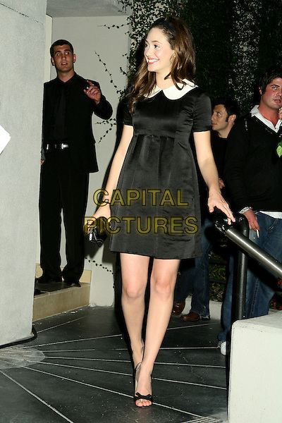 "EMMY ROSSUM.At Teen Vogue's ""Young Hollywood"" Issue Party at the Sunset Tower Hotel, West Hollywood, California, .USA, 20 September 2006..full length black dress white collar.Ref: ADM/BP.www.capitalpictures.com.sales@capitalpictures.com.©Byron Purvis/AdMedia/Capital Pictures."