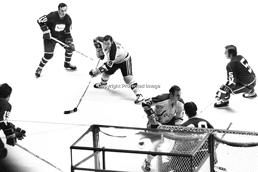 Seals Billy Hicke ready to shoot on Vancouver goalie Dunc Wilson, Gary Jarrett #12, and #5John Schella.<br />
