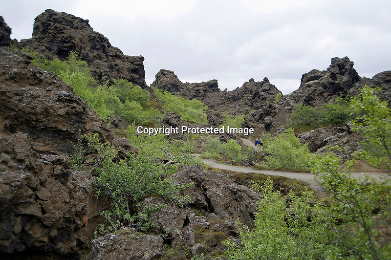 Hikers Exploring the Dimmuborgir Lava Formations nea Lake Myvatn in North-East Iceland