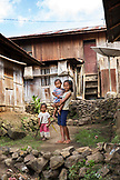 INDONESIA, Flores, kids stand in front of their home in Waturaka Village