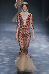Model Delaney walks runway in a nude tulle fishtail gown garnet and bronze floral embroidery, from the Marchesa Fall 2016 collection by Georgina Chapman and Keren Craig, presented at NYFW: The Shows Fall 2016, during New York Fashion Week Fall 2016.