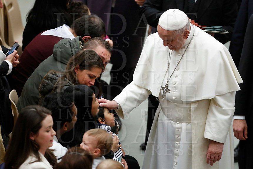 Pope Francis  caresses a child at the end of his weekly general audience in the Paul VI hall at the Vatican, January 22, 2020.<br /> UPDATE IMAGES PRESS/Riccardo De Luca<br /> STRICTLY ONLY FOR EDITORIAL USE