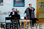Soprano Miriam Murphy accompanied by Aidan O'carroll on the piano, entertains the residents of Baile Mhuire on Friday.