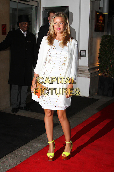 Caggie Dunlop.Daily Mail Inspirational Woman of The Year Awards at the Marriott Grosvenor Square Hotel, London, England..January 18th, 2012.full length coat fur collar white gold studs studded dress yellow platform shoes orange clutch bag jacket.CAP/ROS.©Steve Ross/Capital Pictures