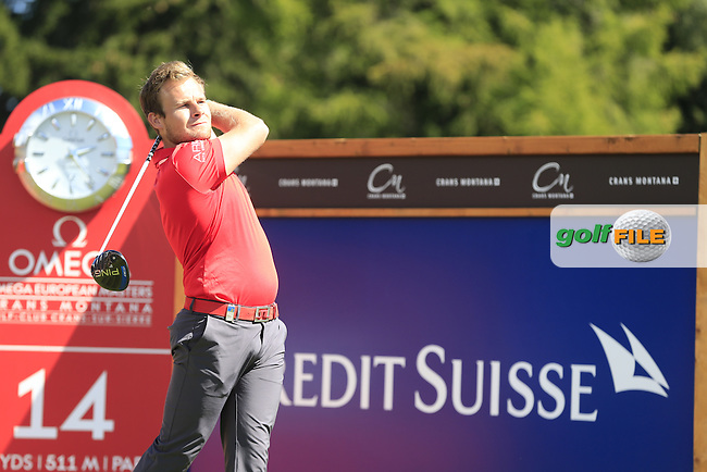 Tyrrell HATTON (ENG) tees off the 14th tee during Saturday's Round 3 of the 2014 Omega European Masters held at the Crans Montana Golf Club, Crans-sur-Sierre, Switzerland.: Picture Eoin Clarke, www.golffile.ie: 6th September 2014