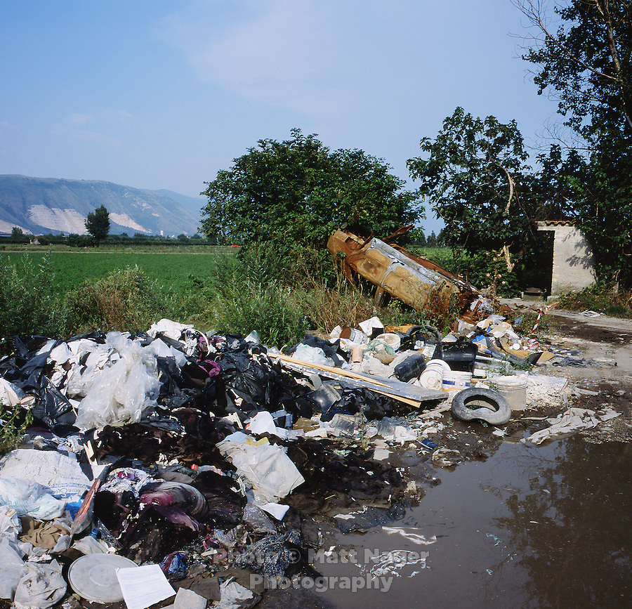 A burned out car and piles of illegally disposed computers, trash, and toxic chemicals lie abandoned next to farm land near Marigliano, Italy. While organized crime can blamed for much of the illegal toxic waste dumping from Northern Italian companies, local citizens have, as well, become accustomed to illegal dumping of waste leading to further contamination of the countryside. ..PHOTOS/ MATT NAGER