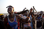 Sunday 5 december 2010 - Juba, Southern Sudan - Fans danced in support of the Mundari wrestlers. Traditional wrestling matches in Juba Stadium between Dinka wrestlers from Yirol East of Lake State and Mundari wrestlers from Terekeka County of Central Equatoria State. The matches attracted large numbers of spectators who sang, played drums and danced in support of their favorite wrestlers. The match organizers hoped that the sport would bring together South Sudan's many different tribes. Photo credit: Benedicte Desrus