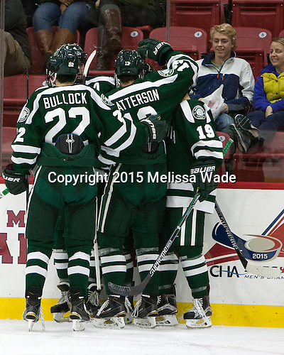 The Big Green celebrate Corey Kalk's (Dartmouth - 18) goal in the second period. - The Harvard University Crimson defeated the Dartmouth College Big Green 5-2 to sweep their weekend series on Sunday, November 1, 2015, at Bright-Landry Hockey Center in Boston, Massachusetts. -