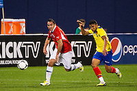 Fernando Meneses (14) of Chile\ is marked by Jefferson Montero (9) of Ecuador. Ecuador defeated Chile 3-0 during an international friendly at Citi Field in Flushing, NY, on August 15, 2012.