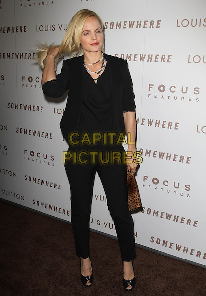 """MENA SUVARI.Premiere of """"Somewhere"""" held At The Arclight Theatres, Hollywood, CA, USA..December 7th, 2010.full length black top jeans denim clutch bag brown leopard print hand flicking hair gesture .CAP/ADM/KB.©Kevan Brooks/AdMedia/Capital Pictures."""