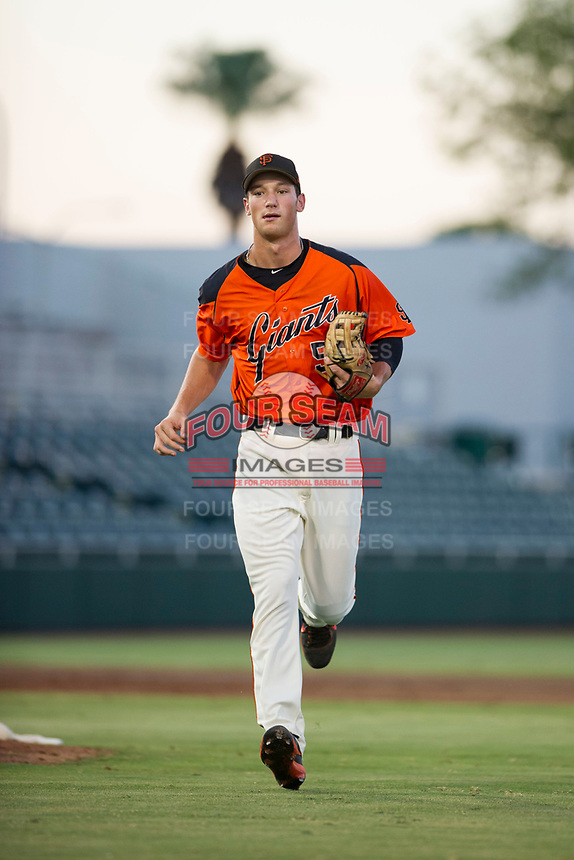 AZL Giants third baseman Jacob Gonzalez (52) jogs off the field between innings of the game against the AZL Athletics on August 5, 2017 at Scottsdale Stadium in Scottsdale, Arizona. AZL Athletics defeated the AZL Giants 2-1. (Zachary Lucy/Four Seam Images)