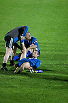 Bangor City 0 FC Honka 1, 23/07/2009. Racecourse Ground, Europa League. A Bangor City player receiving treatment at Wrexham's Racecourse Ground at the end of his sides Europa League second round second leg tie against FC Honka from Finland. The match had to be staged away from City's Farrar Road ground as it did not meet UEFA's stadium standards. The Finns won 1-0 in Wales to go through 3-0 on aggregate in front of 602 spectators in the first season of the newly-introduced competition which replaced the UEFA Cup. Photo by Colin McPherson.
