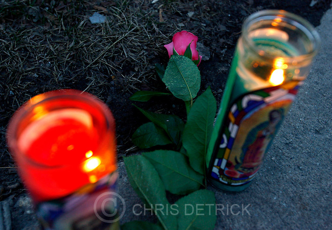 Salt Lake City, UT--2/13/07--7:25:35 AM--.Candles and a flower were put on the corner of 600 East and 500 South, outside of Trolly Square..Trolly Square Tuesday morning after the shootings...*************.. Chris Detrick/Salt Lake Tribune.File #_1CD0741....`.