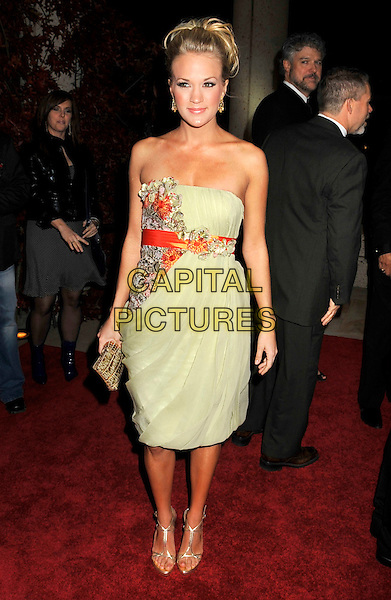CARRIE UNDERWOOD.BMI's 56th Annual Country Awards held at BMI Music Row, Nashville, Tennessee, USA..November 11th, 2008.full length green strapless dress floral print red .CAP/ADM/LF.©Laura Farr/AdMedia/Capital Pictures.