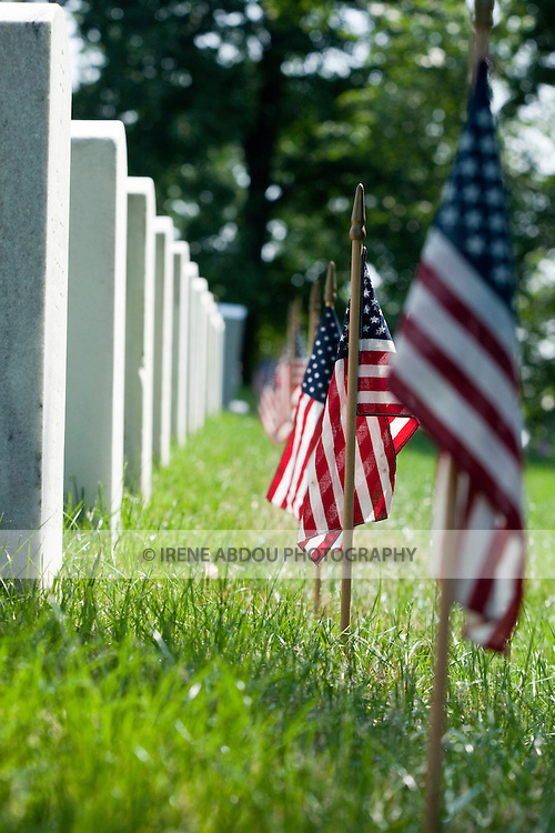 An American flag lines each gravestone in remembrance of soldiers killed in battle on Memorial Day in Arlington National Cemetery, Virginia.