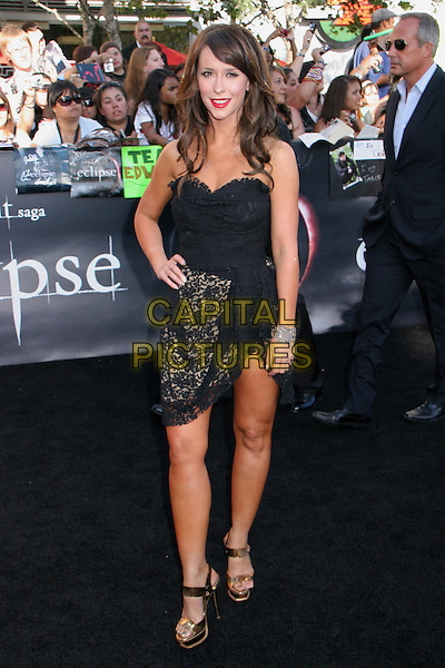 "JENNIFER LOVE HEWITT .attends the 2010 Los Angeles Film Festival Premiere of ""The Twilight Saga: Eclipse"" at the Nokia Theatre L.A. Live, Los Angeles, CA, USA, June 24th, 2010..full length tanned hand on hip dress lace thigh mini platform gold shiny metallic sandals shoes strapless black .CAP/LNC/KR.©Kuroda/LNC/Capital Pictures."