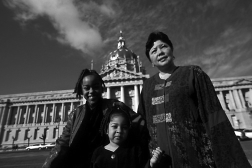clockwise from left: In front of San Francisco's City Hall, Nina and her adoptive mom, Pat, celebrate with her half-sister, Bella, on the day of Nina's official adoption. Bella, who was adopted by Pat a few years earlier, will now have an older sister to share her life with. (photo by Pico van Houtryve)