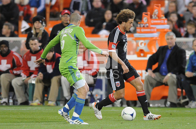 D.C. United midfielder Nick DeLeon (18) goes against Seattle Sounders midfielder Osvaldo Alonso (6) D.C. United tied the Seattle Sounders, 0-0 at RFK Stadium, Saturday April 7, 2012.