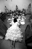 Mae Susana Andrade, a spiritual leader from the Afro Brazilian religion Umbanda, a sect that encompasses an unusual blend of traditions from native indians, African slaves and European colonial rulers, rings the bell as she starts the spiritual session, in her temple in Montevideo, Uruguay. According to Mae Susana the bell calls the attention of the believers but also the attention of the spirits she will work with. Photo by Quique Kierszenbaum
