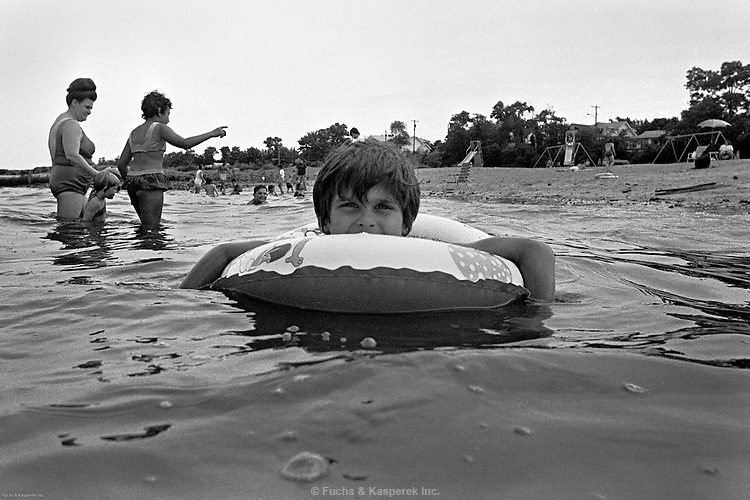 "A boy enjoys a summer float. Jersey shore, 1975. I photographed this after watching the movie ""Jaws."""