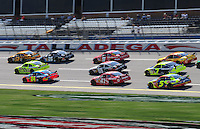 Oct 3, 2008; Talladega, AL, USA; NASCAR Sprint Cup Series drivers race through the tri-oval during practice for the Amp Energy 500 at the Talladega Superspeedway. Mandatory Credit: Mark J. Rebilas-