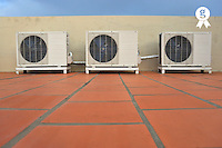 Air-conditioner on building roof floor (Licence this image exclusively with Getty: http://www.gettyimages.com/detail/83154234 )