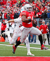 Ohio State Buckeyes running back Carlos Hyde (34) scores the Buckeyes first TD easily against Indiana at Ohio Stadium in Columbus, Ohio on November 23, 2013.  (Chris Russell/Dispatch Photo)