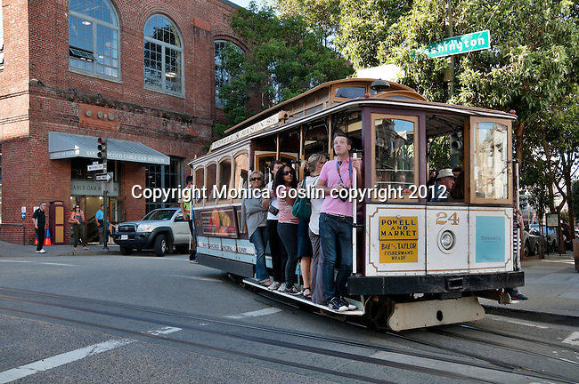 Cable car passing in front of the Cable Car Museum of San Francisco, California