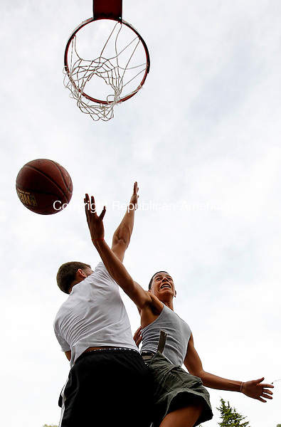 Naugatuck, CT-12, July 2010-071210CM03  Justin Setlock, 17, of Redding, PA goes up for a layup against Ruben Ferreira, 16 of Naugatuck during a one on one basketball game at Linden Park in Naugatuck Monday afternoon.  The two friends were enjoying the warmer weather that has struck the region in recent days.    --Christopher Massa Republican-American