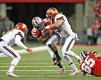 Ohio State Buckeyes running back Ezekiel Elliott (15) gets tackled by Illinois Fighting Illini defensive back Taylor Barton (3) (right) and Illinois Fighting Illini defensive back Caleb Day (7) in the first quarter of the game at Ohio Stadium on November 1, 2014. (Chris Russell/Dispatch Photo)