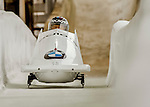 8 January 2016: Alexey Stulnev, piloting his 2-man bobsled for Russia, enters the Chicane straightaway on his second run, ending the day with a combined 2-run time of 1:51.81 and earning a 14th place finish at the BMW IBSF World Cup Championships at the Olympic Sports Track in Lake Placid, New York, USA. Mandatory Credit: Ed Wolfstein Photo *** RAW (NEF) Image File Available ***