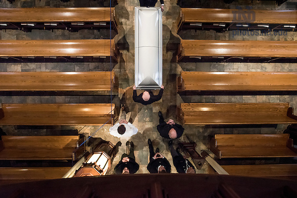 Mar. 3, 2015; Holy Cross priests and seminarians accompany the casket of President Emeritus Rev. Theodore M. Hesburgh into the Basilica of the Sacred Heart for the visitation and wake. (Photo by Barbara Johnston/University Photographer)
