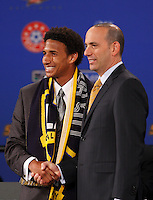 Los Angeles Galaxy first pick and fourth overall Sean Franklin poses for photos with MLS commissioner Don Garber during the MLS SuperDraft at the Baltimore Convention Center in Baltimore, MD, on January 18, 2008.