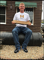 BNPS.co.uk (01202 558833)<br /> Pic: JasonBaker/BNPS<br /> <br /> Jason Baker with the ingot he discovered.<br /> <br /> Weighty find - 85lb Roman lead from a Somerset mine turns up 2000 years later.A treasure hunting bricklayer who unearthed a 2,000-year-old Roman ingot on a farm is now set to profit at auction.  Jason Baker found the 2ft long lead bar with his metal detector on a routine rally in the Mendip Hills near Wells, Somerset, last year.Amazingly the ingot is still inscribed with the name of emperor Marcus Aurelius Armeniacus dating it to 164 AD, and would have been destined for Imperial Rome had it not been lost at the time.It will be sold in Etwall, just outside Derby in Derbyshire, on March 22, when it's expected to fetch &pound;15,000.