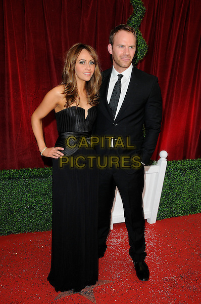 Samia Smith (Ghadie) & Will Thorpe.Coronation Street.Attending the British Soap Awards 2012.at the London Television Centre, London, England, UK, 28th April 2012..arrivals full length black dress strapless long maxi hand on hip suit tie .CAP/CAN.©Can Nguyen/Capital Pictures.