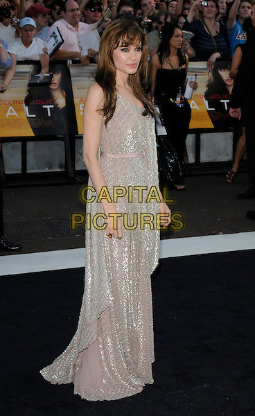 "ANGELINA JOLIE .Attending the UK Film Premiere of ""Salt"", Empire cinema, Leicester Square, London, England, UK, .August 16th 2010..full length long maxi dress gold silver beige sequined sequin nude sleeveless  beaded.CAP/CAN.©Can Nguyen/Capital Pictures."