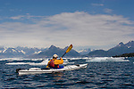 Alaska, Prince William Sound, Sea kayaker paddles through ice, Columbia Bay,  USA,