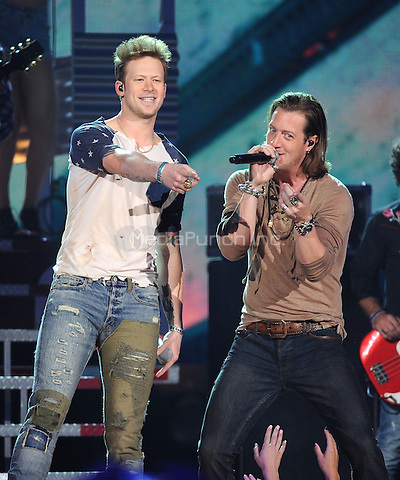 LAS VEGAS, NV - MAY 18: 5 Brian Kelly and Tyler Hubbard of Florida Georgia Line performs on the 2014 Billboard Music Awards at the MGM Grand Garden Arena on Sunday, May 18, 2014 in Las Vegas, Nevada. PgMicelotta/MediaPunch