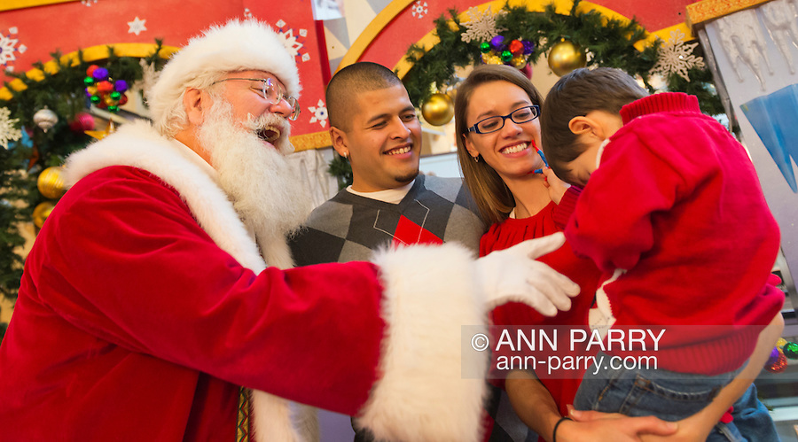 "Nov. 21, 2012 - Garden City, New York, U.S. - Santa Claus gets a visit from PATRICK HERR, 3 1/2, from Hempstead, at Roosevelt Field shopping mall in Long Island. Patrick's mom JULIANA CARREON and ISMAEL CARREON took him to visit the jolly man who says ""Ho, ho, ho!"" Roosevelt Field is one of the 10 largest shopping malls in the United States of America, and is on the site where aviator Charles Lindbergh began his historic solo transatlantic flight to Paris in 1927."