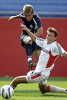 New England Revolution's Taylor Twellman crosses a ball past the defense of D.C. United's Brandon Prideaux during scoreless first half action between the New England Revolution and D.C. United in MLS play at Gillette Stadium, Foxboro, MA on Saturday August 28, 2004.