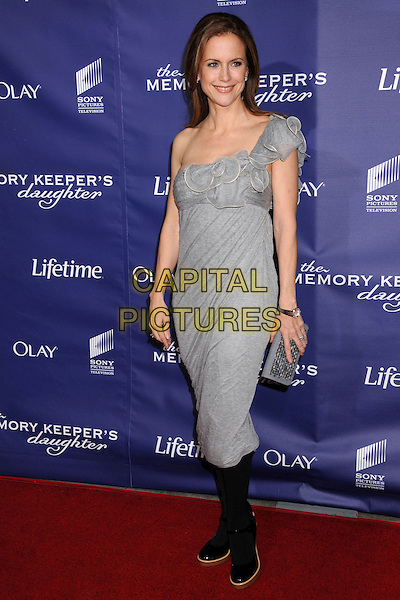 "KELLY PRESTON .""The Memory Keeper's Daughter"" Los Angeles Premiere at the Cinerama Dome, Hollywood, California, USA,.8 April 2008..full length grey gray one shoulder dress black tights shoes clutch bag purse .CAP/ADM/BP.©Byron Purvis/Admedia/Capital PIctures"