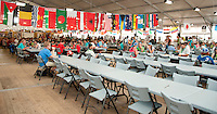 The huge dining hall looks much better with all the flags. Photo: Johanna Mårtensson/Scouterna
