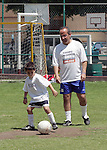 Mexican  right-wing National Action Party (PAN) candidate for Presidency Felipe Calderon plays with his son during a soccer match with reporters in a Mexico City school, March 20, 2006. A poll released by a Mexican newspaper indicates that leftist candidate Andres Manuel Lopez Obrador holds an 8 percentage point lead over ruling party candidate Felipe Calderon and PRI candidate Roberto Madrazo. Photo by Javier Rodriguez