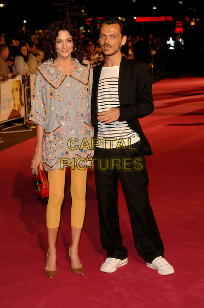 """ASTRID MUNOZ & MATTHEW WILLIAMSON.At the UK Film Premiere of """"Factory Girl"""", held at Vue West End Cinema, London, England, March 13th 20007..full length designer black suit white trainers yellow footless tights leggings tunic dress black and white striped top.CAP/PL.©Phil Loftus/Capital Pictures"""