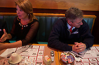 Senator Scott Brown (R-MA) and wife Gail Huff sit in a booth at a meeting of the Law Enforcement Coalition for Brown at Johnny Jack's Restaurant in Milford, Massachusetts, USA, on Thurs., Nov. 2, 2012. Senator Scott Brown is seeking re-election to the Senate.  His opponent is Elizabeth Warren, a democrat.