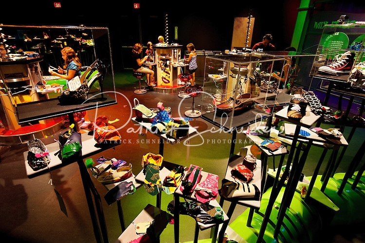 "Visitors to Charlotte's Discovery Place museum are inspired to imagine and innovate with the museum's new ""Think it Up"" exhibits. Here, kids of all ages design footwear, in the Designing Foodwear exhibit. Discovery Place, Charlotte NC's interactive children's museum, unveiled its interactive exhibits and hands-on activities in June 2010. Renovations of the popular family museum were made possible by the City of Charlotte, the Arts and Science Council and private donations. Discovery Place museum has age-appropriate exhibits for kids of all ages."