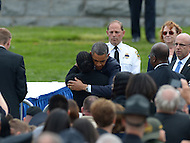 May 15, 2013  (Washington, DC)  President Barack Obama consoles a survivor of a fallen officer at the 32nd Annual Peace Officers memorial Service on the west lawn of the U.S. Capitol.  (Photo by Don Baxter/Media Images International)