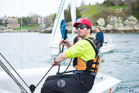 Brian Baker, '18, works the sail as the Salve Regina Sailing Team practices in Newport Harbor.