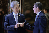 Ahn Ho-young (l) , Ambassador of South Korea to the United States, speaks with retired Lt. Gen. Michael Flynn, President-elect Donald Trump's pick for National Security Adviser,  in lobby of the Trump Tower in New York, NY, on January 4, 2017. <br /> Credit: Anthony Behar / Pool via CNP